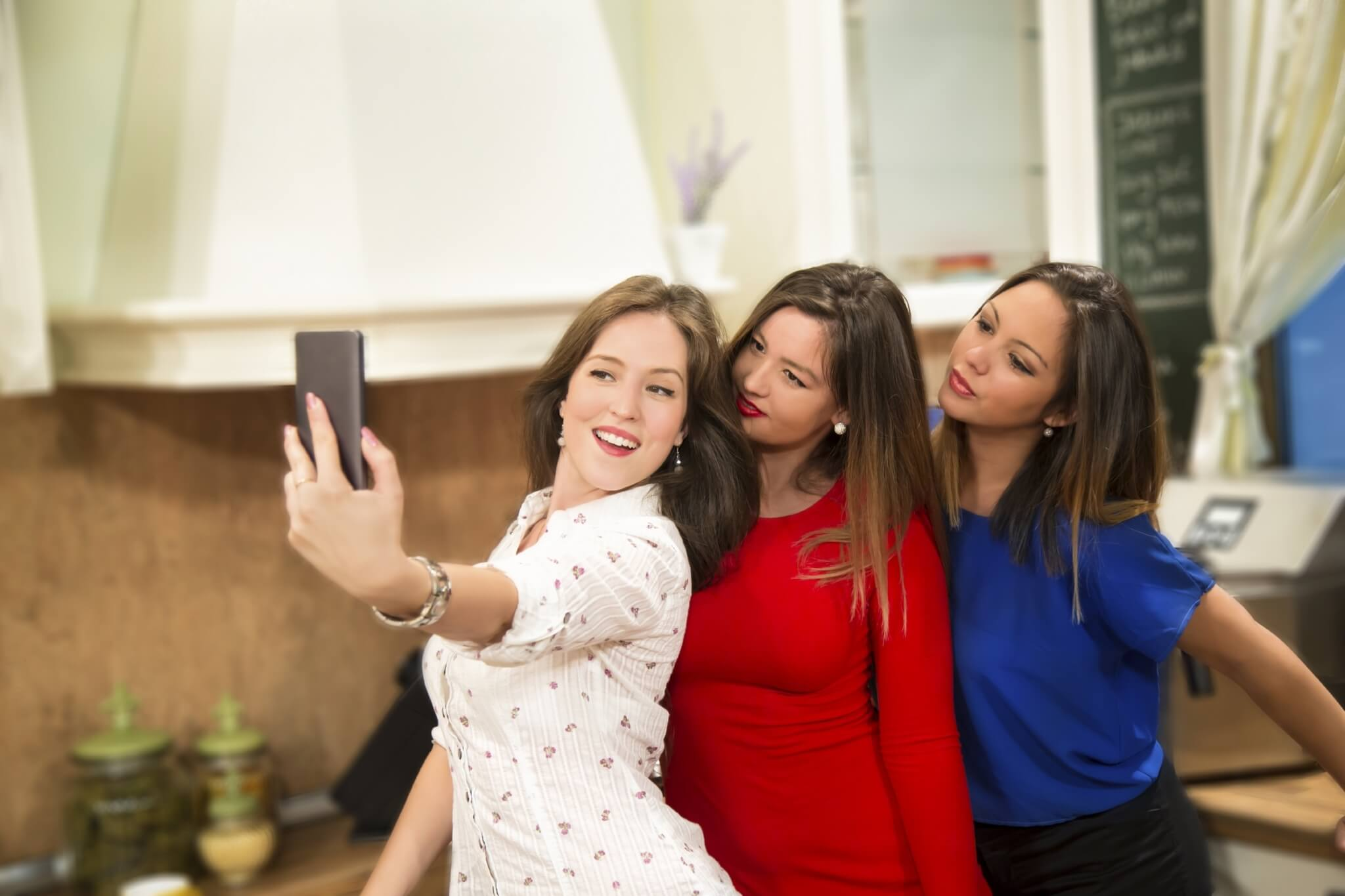 Young-women-taking-selfie-with-smart-phone-at-home-000070919941_Large.jpg.jpeg