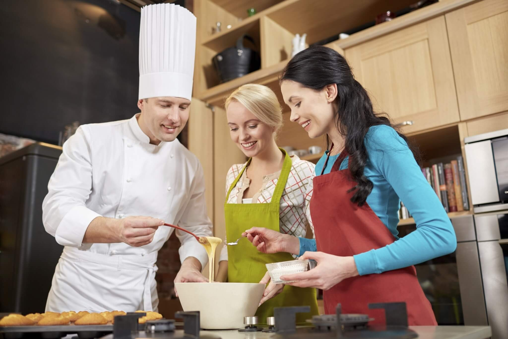 happy-women-and-chef-cook-baking-in-kitchen-000070772171_Full-1.jpg.jpeg